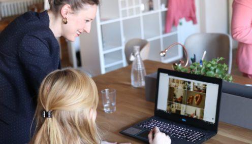 Female leader delegating tasks and helping an intern