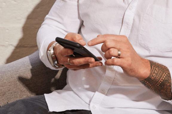 Close up of man using his smart phone.