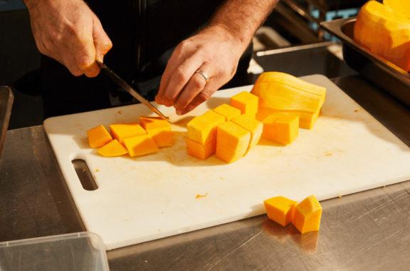 Chef cutting up pumpkin