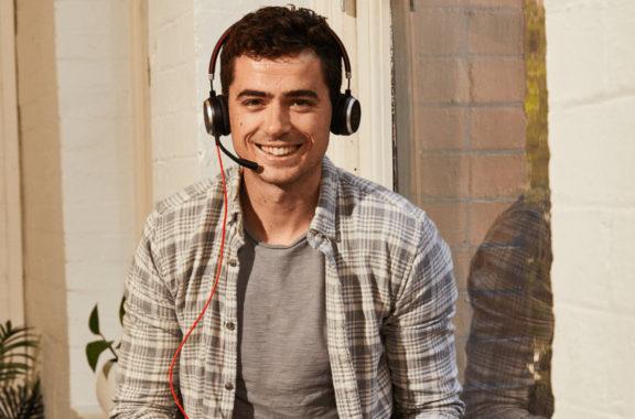 Man smiling talking on a headset