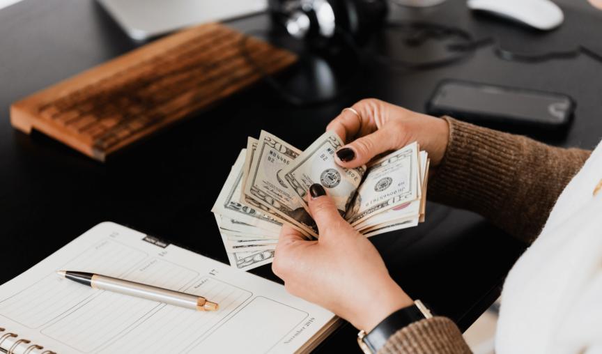 a woman handling money