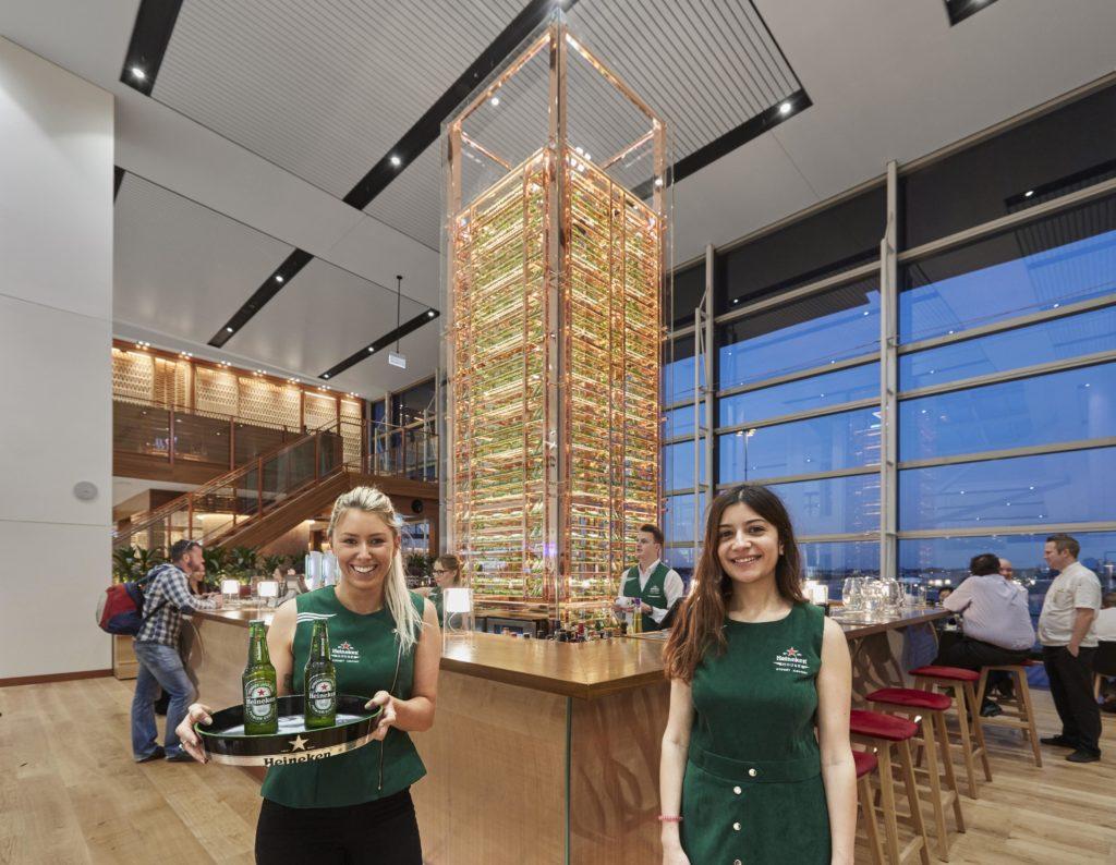 Two female staff members ready to greet customers at Heineken House.