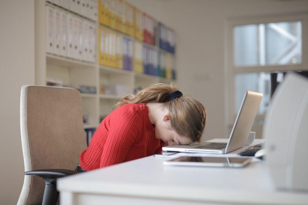 woman sleeping at work