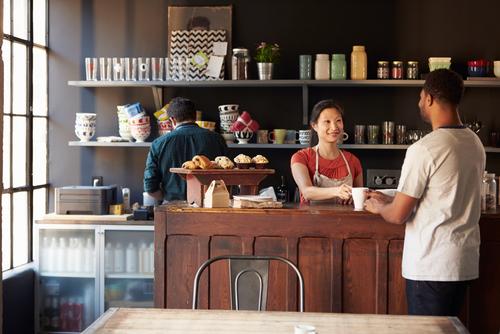 Barista serving a customer in a coffee shop