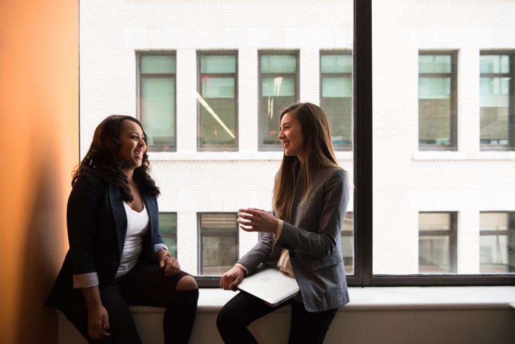 Two women by window